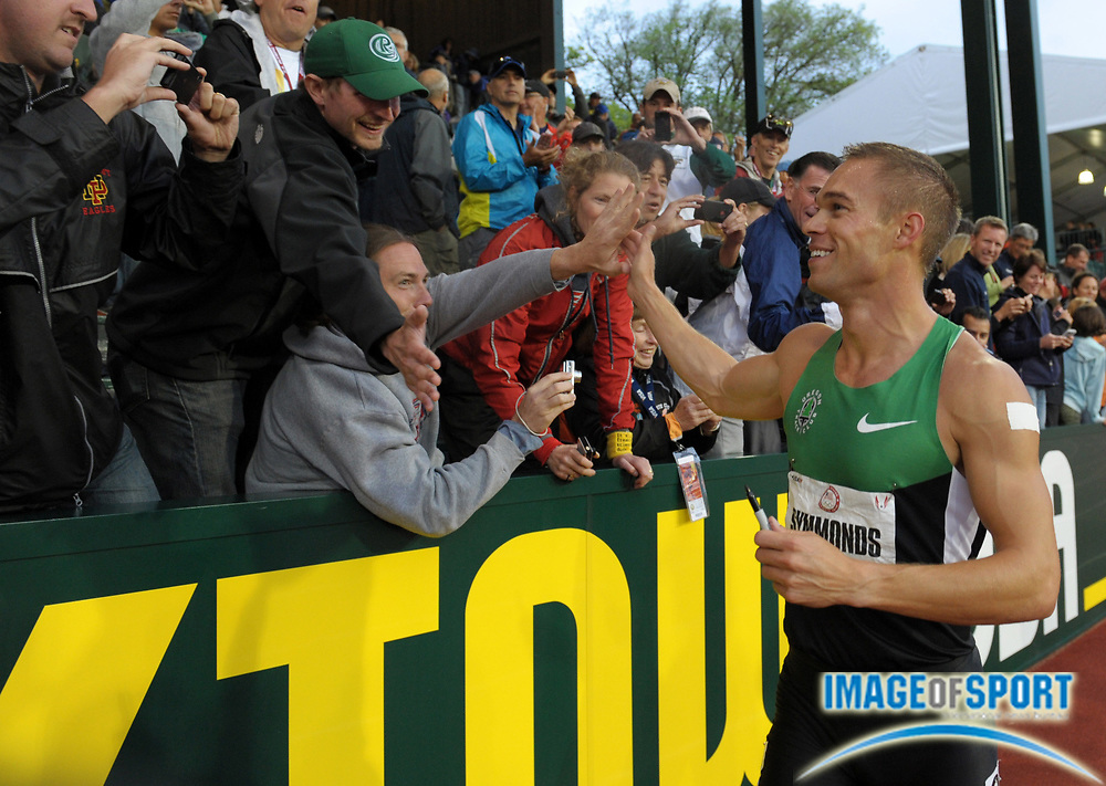 Jun 25, 2012; Eugene, OR, USA; Nick Symmonds takes a victory lap after winning the 800m in 1:43.92 in the 2012 U.S. Olympic Team Trials at Hayward Field.