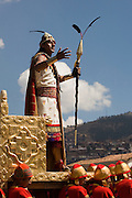 """The Sapa Inca stands in his golden chair as the highest authority from the Inti Raymi. Inti Raymi """"Festival of the Sun"""", Plaza de Armas, Cusco, Peru."""