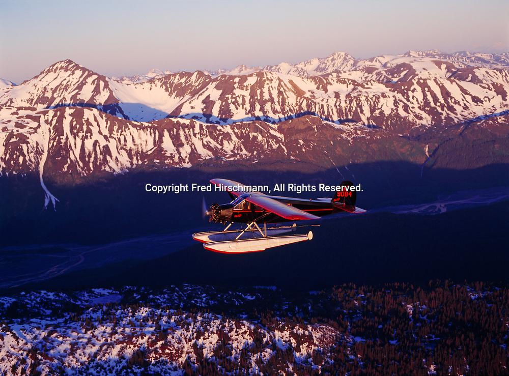 Bill de Creeft of Kachemak Bay Flying service flying his antique 1929 Travel Air S6000B on floats above Wosnesenski River, Kachemak Bay State Park, Alaska.
