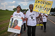 """Robert Taylor and Sharon Lavigne, leading the march on the second day of a five day march through Louisiana's 'Cancer Alley' held by the Coalition Against Death Alley. The Coalition Against Death Alley (CADA), is a group of Louisiana-based residents and members of various local and state organizations, is calling for a stop to the construction of new petrochemical plants and the passing of stricter regulations on existing industry in the area that include the groups RISE St. James, Justice and Beyond, the Louisiana Bucket Brigade, 350 New Orleans, and the Concerned Citizens of St. John  Louisiana's Cancer Alley, an 80-mile stretch along the Mississippi River, is also known as the """"Petrochemical Corridor,"""" where there are over 100 petrochemical plants and refineries"""