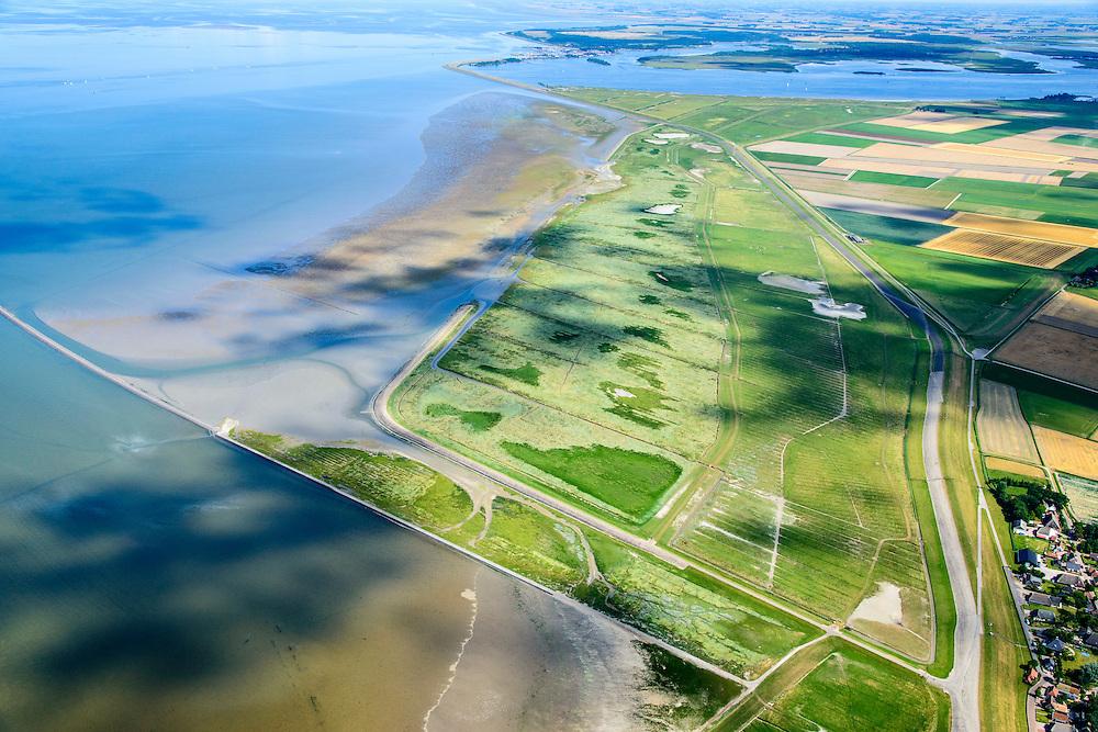 Nederland, Friesland, Gemeente Dongeradeel, 05-08-2014;; Peazemerlannen, kweldergebied grenzend aan het Wierumerwad en de Waddenzeee. Boven in beeld Lauwersmeer.<br /> Het gebied is ontstaan door spontane uitpoldering bij een storm in 1973 waarbij er een gat geslagen werd in de dijk. Rechts de zeedijk (op delta hoogte) in het midden de zigzag lopende dijk van de zomerpolder. Het natuurgebied is in beheer bij It Fryske Gea. <br /> <br /> Peazemerlannen, salt marshes bordering the Wierumerwad and Waddenzeee. The area has been created in 1973, a severe storm made a hole in the outside polder dike. Right the seawall (delta height), in the middle of the zigzag dike of the summer polder. The area is a nature reserve, managed by It Fryske Gea.<br /> luchtfoto (toeslag op standard tarieven);<br /> aerial photo (additional fee required);<br /> copyright foto/photo Siebe Swart