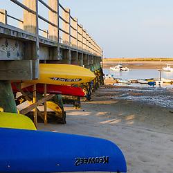 Kayaks under the pier in Pamet Harbor in Truro, Massachusetts. Cape Cod.