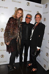 Left to right, EVA HERZIGOVA and ROBERTO & EVA CAVALLI  at a party hosted by Roberto Cavalli to celebrate his new Boutique's opening at 22 Sloane Street, London followed by a party at Battersea Power Station, London SW8 on 17th September 2011.