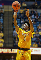 Nov 24, 2018; Morgantown, WV, USA; Valparaiso Crusaders guard Bakari Evelyn (4) shoots a three pointer during the first half against the West Virginia Mountaineers at WVU Coliseum. Mandatory Credit: Ben Queen-USA TODAY Sports