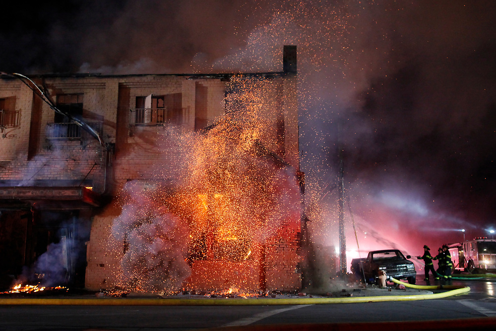 The burning roof of the first floor collapses as firefighters work to contain a massive blaze that consumed The Swinging Door building on Soledad Street in Chinatown in Salinas, Calif. on March 18, 2017.