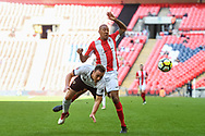 Jordan Higgs of Bromley FC (14) and Glenn Walker of Brackley Town (7) battle for the ball during the FA Trophy match between Brackley Town and Bromley at Wembley Stadium, London, England on 20 May 2018. Picture by Stephen Wright.