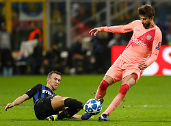 November 7, 2018 - Milan, Italy - Ivan Perisic (L) of Inter Milan and Gerard Pique of Barcelona vie for the ball during the Group B match of the UEFA Champions League between FC Internazionale and FC Barcelona on November 6, 2018 at San Siro Stadium in Milan, Italy. (Credit Image: © Mike Kireev/NurPhoto via ZUMA Press)
