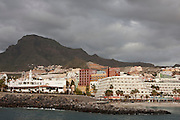 The beach at Playa del Puerto de Colon, Costa Adeje, Tenerife, from the breakwater at Puerto de Colon in the late evening during February.