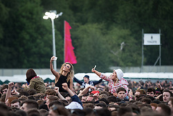 © Licensed to London News Pictures . 05/06/2015 . Manchester , UK . Crowd watching the performances . Evening concerts featuring headliners , The Courteeners , playing a homecoming gig , at Heaton Park in Manchester in front of 25,000 people , the evening before the Parklife music festival . Photo credit : Joel Goodman/LNP