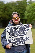 About 500 residents of Folkestone gathered to Take the Knee at Radnor Park for a socially distanced show of solidarity in memory of George Floyd, the man recently murdered by Police in Minneapolis, United States on Sunday the 7th of June 2020 in Folkestone, United Kingdom. Home made banners with the slogans Black Lives Matter, Be Anti Racist, All Equal, End Racism and Always Challenge Racism could be seen.