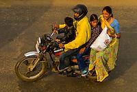 A family riding on a motorcycle near Choti Chaupar (circle) in Jaipur, Rajasthan, India