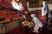 The mother of camp leader Haji Bootoo Boi, who just went to Haj, is reading the Holy Koran..The Kyrgyz settlement of Tchelab, near Chaqmaqtin lake, Haji Bootoo Boi's camp...Trekking through the high altitude plateau of the Little Pamir mountains, where the Afghan Kyrgyz community live all year, on the borders of China, Tajikistan and Pakistan.