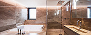 Luxurious marble bathroom with hydromassage for two people. Nobody inside