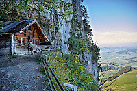 Photo of Berggasthaus Aescher -Wildkirchli, a mountain weathered terrace on the Ebenalp Summit in Switzerland with a scenic view of the Swiss Alps