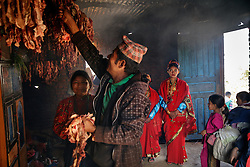 The sixteen-year-old bride, Anita, watches as the wedding feast is prepared by her family.<br /> <br /> The 2015 earthquakes devastated Nepal and left girls and women in an increasingly vulnerable position, leading experts to believe child marriage rates will increase over the coming years.