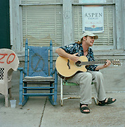 Blues singer outside the Ground Zero Blues Club, Clarksdale, Mississippi. Muddy Waters, Robert Johnson, Bessie Smith, and ZZ Top are some of the many musicians who have put Clarksdale on the map: with its own blues museum on Blues Alleyit is no surprise to hear that  Clarksdale it is famous for being 'the birth place of the Blues'.