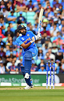Cricket - 2019 ICC Cricket World Cup - Group Stage: India vs. Australia<br /> <br /> India's Rohit Sharma unsettled by a delivery from Australia's Mitchell Starc, at The Kia Oval.<br /> <br /> COLORSPORT/ASHLEY WESTERN