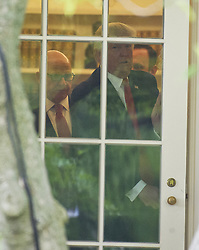 June 16, 2017 - Washington, District of Columbia, United States of America - United States President DONALD J. TRUMP, followed by US National Security Advisor H. R. MCMASTER  prepares to open the door to depart the Oval Office of the White House in Washington, DC for a trip to Miami, Florida.  In Miami, the President will give remarks and participate in a signing on the United States' policy towards Cuba. (Credit Image: © Ron Sachs/CNP via ZUMA Wire)