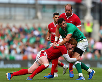 Rugby Union - 2019 pre-Rugby World Cup warm-up (Guinness Summer Series) - Ireland vs. Wales<br /> <br /> Rhys Patchell (Wales) tackles Robbie Henshaw (Ireland) at The Aviva Stadium.<br /> <br /> COLORSPORT/KEN SUTTON
