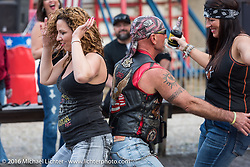 Dancing in front of the stage at the Iron Horse Saloon in Ormond Beach was very busy on this Friday, the day before the official start of the Daytona Bike Week 75th Anniversary event. FL, USA. Friday March 4, 2016.  Photography ©2016 Michael Lichter.