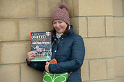 Lincoln City fan selling copies of A City United fan magazine during the EFL Sky Bet League 2 match between Lincoln City and Grimsby Town FC at Sincil Bank, Lincoln, United Kingdom on 17 March 2018. Picture by Craig Zadoroznyj.