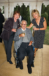 Left to right, SIR JOHN & LADY MORTIMER and ELIZABETH CLOUGH wife of Jeremy Paxman at a party to celebrate the publication of Notting Hell by Rachel Johnson held in the gardens of 1 Rosmead Road, London W11 on 4th September 2006.<br /><br />NON EXCLUSIVE - WORLD RIGHTS