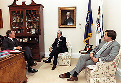 United States Vice President George H.W. Bush, left, discusses US President Ronald Reagan's schedule with Donald Regan, Chief of Staff to the President, center, and Craig Fuller, Chief of Staff to the Vice President. The three men met shortly before noon on July 15, 1985 in the Vice President's West Wing office. Vice President Bush cancelled a trip to Missouri and Ohio in order to be in Washington this week for the conduct of official business.<br /> Photo by David Valdez / White House via CNP/ABACAPRESS.COM