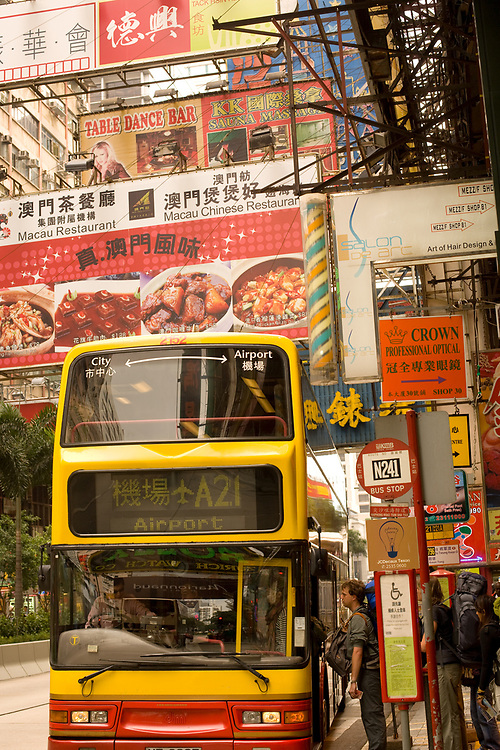 Hong Kong, China, Asia - Tourists boarding a bus to the Airport at Nathan Road, Tsimshatsui, Kowloon,