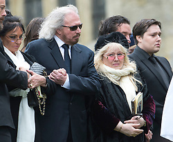 © London News Pictures. 08/06/2012. Thame, UK.  L to R Barry Gibb (brother), Dwina Gibb (wife) and Robin?John Gibb (son) at the burial of former Bee Gee Robin Gibb at St Mary's Church in Thame, Oxfordshire  on June 8, 2012. Robin Gibb died on May 20, 2012 aged 62 following a long battle against cancer. Photo credit: Ben Cawthra/LNP