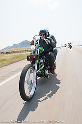 Karen and Bill Stevens of Grand Rapids riding their custom 1968 Yamaha SX-650 chopper north on highway 79 on the Run to the Line for lunch and biker vs Cowboy rodeo games at the Spur Creek Ranch in Newell during the annual Sturgis Black Hills Motorcycle Rally. SD, USA. Wednesday August 9, 2017. Photography ©2017 Michael Lichter.