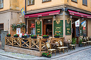 Stockholm, Sweden -- July 16, 2019. A couple is having a late breakfast outdoors at a cafe in Old Town, Stockholm.