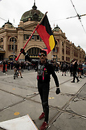 A proud Aboriginal man holds his flag outside of Flinders Street Station after a confrontation with a member of the Proud Boys during a march through the city of Aboriginal people and their supporters in Melbourne on Australia Day (which they called, 'Invasion Day'). Australia marks the anniversary of the arrival of the First White Settlers in Australia. (Photo by Michael Currie/Speed Media)