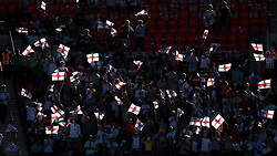 England fans wave flags during the game