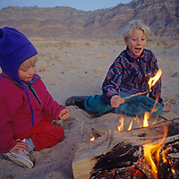 Youngsters play around a campfire in Eureka Valley, part of California's Death Valley National Park.