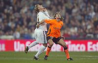 15/2/2004 Madrid, Spain.<br />La Liga (Spanish League), stage 24.<br />R.Madrid 1 - Valencia 1<br />R.Madrid's Guti in duel with Valencia's Angulo at Santiago Bernabeu's Stadium.<br />© 2004 Alejandro leon Fernandez