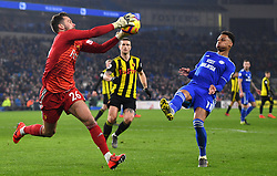 Watford goalkeeper Ben Foster (left) and Cardiff City's Josh Murphy battle for the ball during the Premier League match at the Cardiff City Stadium.