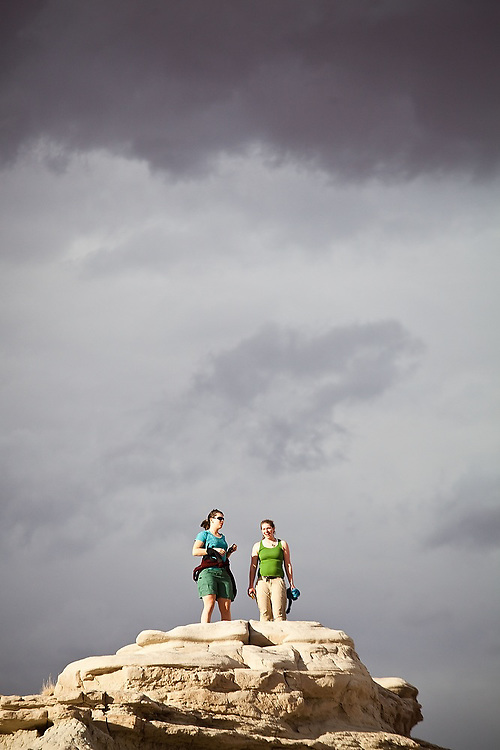 Katy Barnhart and Jessica Stanley, on a geology field trip with the University of Colorado, stand on the summit of a high mesa at Goblin Valley State Park, Utah.
