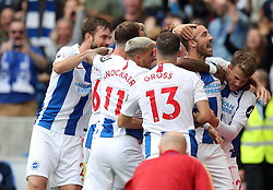 Brighton & Hove Albion's Glenn Murray (right) celebrates scoring his side's first goal of the game with team mates during the Premier League match at the AMEX Stadium, Brighton.