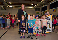 Gilford Elementary Kindergarteners ring the bell with Jessica Richardson from the EDies group after receiving the 2018 Elementary School of Excellence Award Thursday morning.  (Karen Bobotas/for the Laconia Daily Sun)