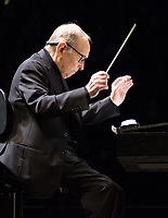 Ennio Morricone, died aged 91 in hospital after he  fractured his femur when he fall a few days in Rome <br />  Ennio Morricone BAFTA winning Italian composer and his orchestra perform rare London date of European tour at  The O² Arena  16TH FEB 2016