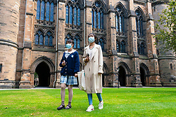 Glasgow, Scotland, UK. 25 September, 2020. Many students at Glasgow University have tested positive for the Covid-19 virus. The Scottish Government has controversially ordered students in several halls of residence where positive cases have spiked, to self-isolate indefinitely. Pictured; Chinese mother and young daughter visiting campus .  Iain Masterton/Alamy Live News