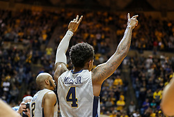 Feb 26, 2018; Morgantown, WV, USA; West Virginia Mountaineers guard Daxter Miles Jr. (4) waves to the crowd during senior night ceremonies before their game against the Texas Tech Red Raiders at WVU Coliseum. Mandatory Credit: Ben Queen-USA TODAY Sports