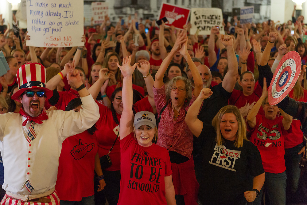 Teachers and school personnel celebrate after the House of Delegates passed a motion to postpone indefinitely a vote on Senate Bill 451 at the West Virginia State Capitol in Charleston, W.Va. during a statewide strike by teachers and school personnel on Tuesday, February 19, 2019.