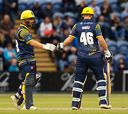 Glamorgan's David Lloyd congratulates Chris Cooke on a boundary<br /> <br /> Photographer Simon King/Replay Images<br /> <br /> Vitality Blast T20 - Round 14 - Glamorgan v Surrey - Friday 17th August 2018 - Sophia Gardens - Cardiff<br /> <br /> World Copyright © Replay Images . All rights reserved. info@replayimages.co.uk - http://replayimages.co.uk