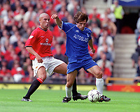 Gainfranco Zola (Chelsea) and Mikael Silvestre (Man Utd). Manchester United v Chelsea. FA Premiership, 23/9/00. Credit: Colorsport / Paul Roberts.