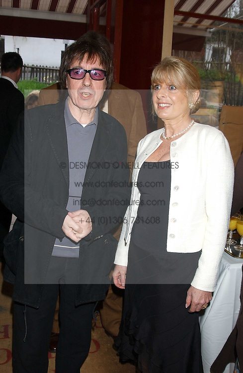 BILL WYMAN and GILL CATTO at a private view of paintings by singer Tony Bennett held at the catto Gallery, 100 Heath Street, London NW3 on 5th April 2005.<br />