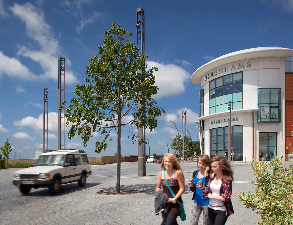 Three girls and a car in newly landscaped area of central ashford, kent