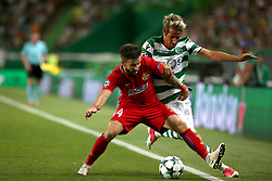 August 15, 2017 - Lisbon, Portugal - Sporting's defender Fabio Coentrao from Portugal vies with Steaua's midfielder Gabriel Enache (L) during the UEFA Champions League play-offs first leg football match between Sporting CP and FC Steaua Bucuresti at the Alvalade stadium in Lisbon, Portugal on August 15, 2017. (Credit Image: © Pedro Fiuza/NurPhoto via ZUMA Press)
