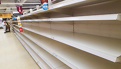 © Licensed to London News Pictures. 03/03/2018. Salford, UK. Empty shelves, depleted of all stock of bread, at a branch of Sainsbury's supermarket in Salford today as it's reported snow has prompted panic buying of food staples . Photo credit: Joel Goodman/LNP