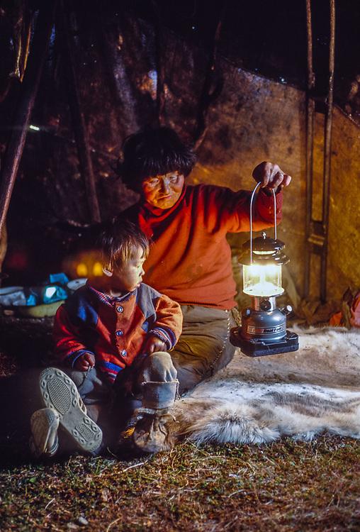 Olga Tinachvanau and grand son testing new lantern, , Chukchi reindeer camp, Senyavina Strait, Chukotsk Peninsula, NE Russia